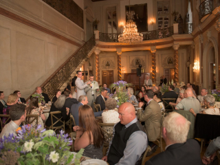 <h2>Dinner toasts in the Ballroom</h2>Photo by Kevin Allen.