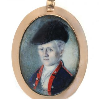 Oval watercolor portrait miniature of William Truman Stoddert wearing a military uniform, in a gold case, after conservation treatment