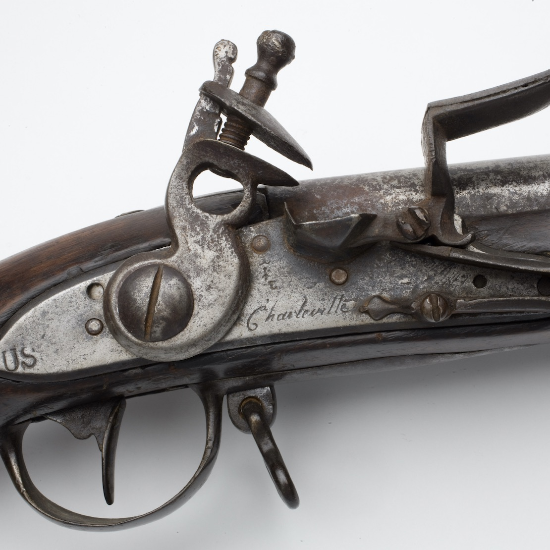 The lock of a Charleville musket, showing French and American marks, illustrates details used to interpret artifacts of the Revolutionary War.