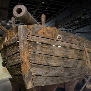 Bow of the wood gunboat Philadelphia with an iron cannon