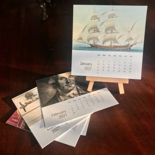 Desk calendar of individual cards with images of Institute collections with a wooden easel
