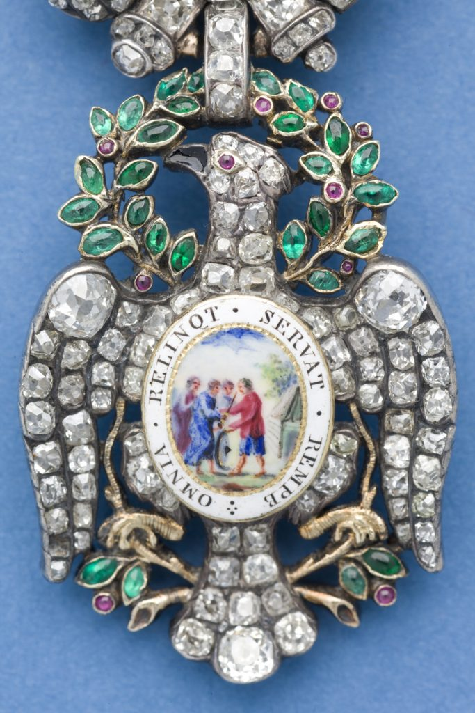 Detail of the front side of the body of the Diamond Eagle insignia of the Society of the Cincinnati adorned with gemstones and enamel