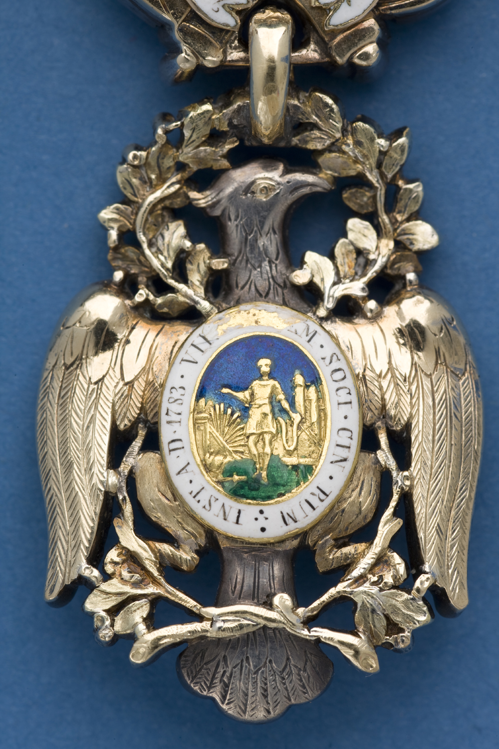 Detail of the back side of the gold-and-enamel body of the Diamond Eagle insignia