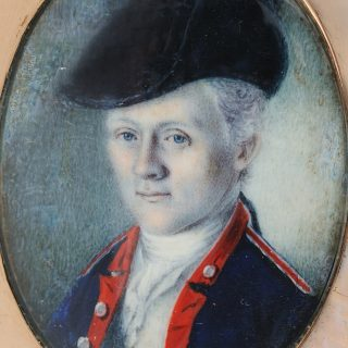 Detail of an vval watercolor portrait miniature of William Truman Stoddert wearing a military uniform, in a gold case, after conservation treatment